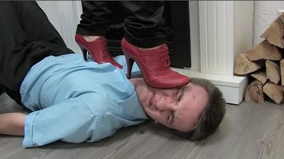 Slave suffers under high heels